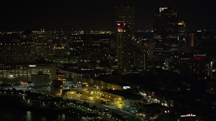 5K stock footage aerial video flyby Downtown New Orleans skyscrapers near the Westin hotel at night, Louisiana Aerial Stock Footage | AX63_005