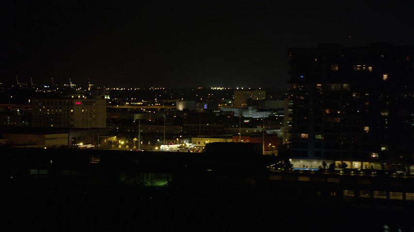 5K stock footage aerial video of Downtown New Orleans riverfront hotels and skyscrapers at night, Louisiana Aerial Stock Footage | AX63_006
