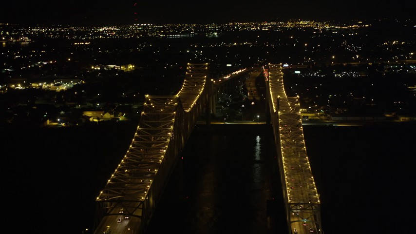 5K aerial video flyby the Crescent City Connection Bridge at night, New Orleans, Louisiana Aerial Stock Footage | AX63_015
