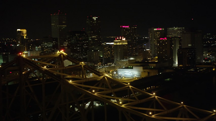 5K aerial video orbit top of Crescent City Connection Bridge at night to reveal Downtown New Orleans, Louisiana Aerial Stock Footage | AX63_016