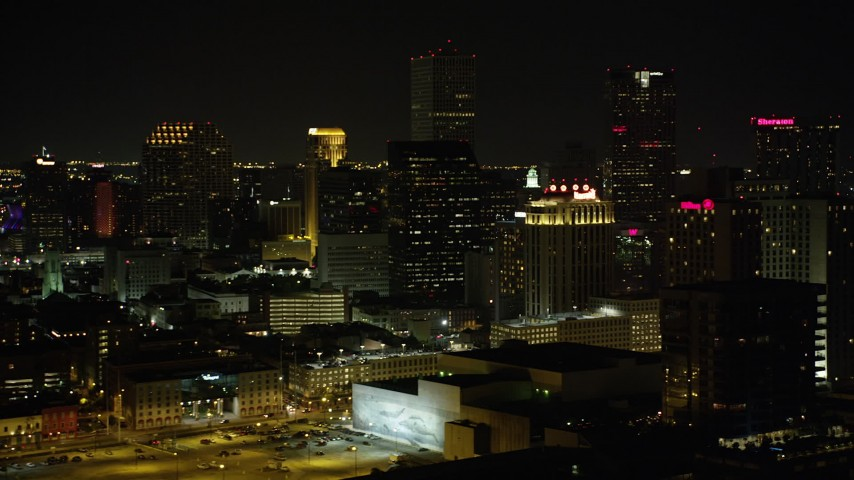 5K aerial video flyby hotels and skyscrapers in Downtown New Orleans at night, Louisiana Aerial Stock Footage | AX63_017