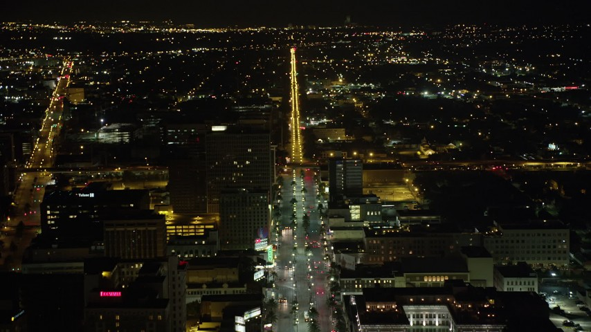 5K aerial video follow Canal Street through Downtown New Orleans at night, Louisiana Aerial Stock Footage | AX63_019