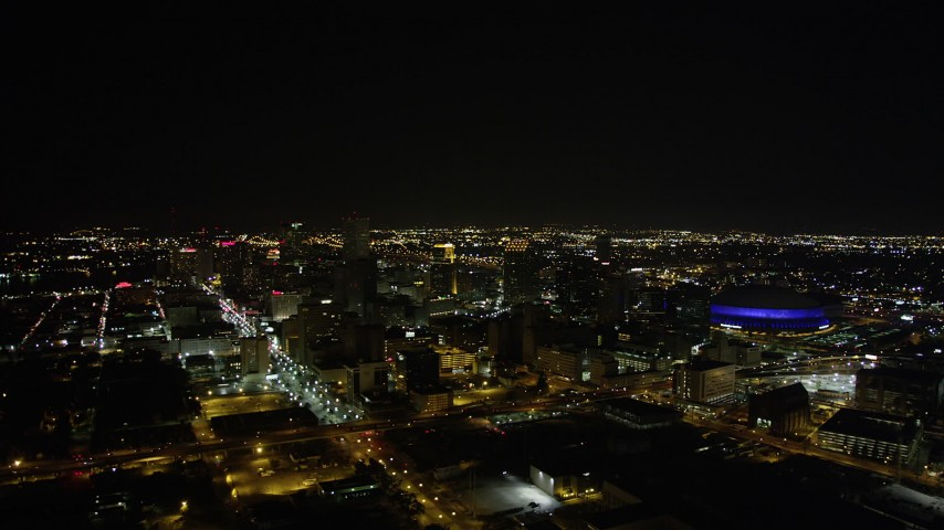5K aerial video of a wide view of Downtown New Orleans at night, Louisiana Aerial Stock Footage | AX63_028