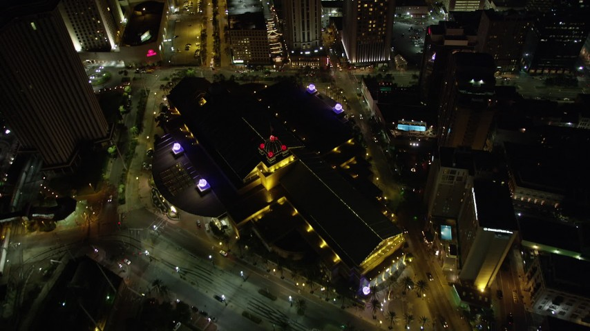 5K aerial video of bird's eye view of The Westin and Harrah's at night in Downtown New Orleans, Louisiana Aerial Stock Footage | AX63_030