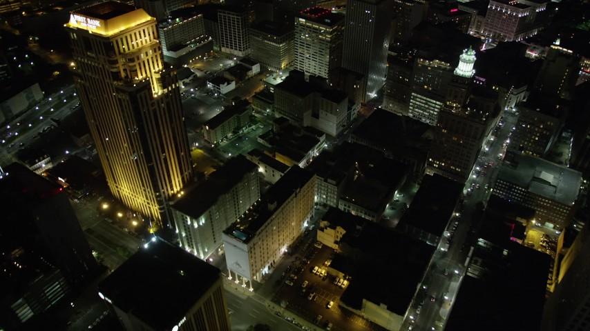 5K stock footage aerial video of bird's eye of Downtown New Orleans skyscrapers and streets at night, Louisiana Aerial Stock Footage | AX63_031