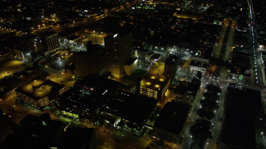 5K stock footage aerial video of Downtown New Orleans buildings and streets at night, Louisiana Aerial Stock Footage | AX63_032
