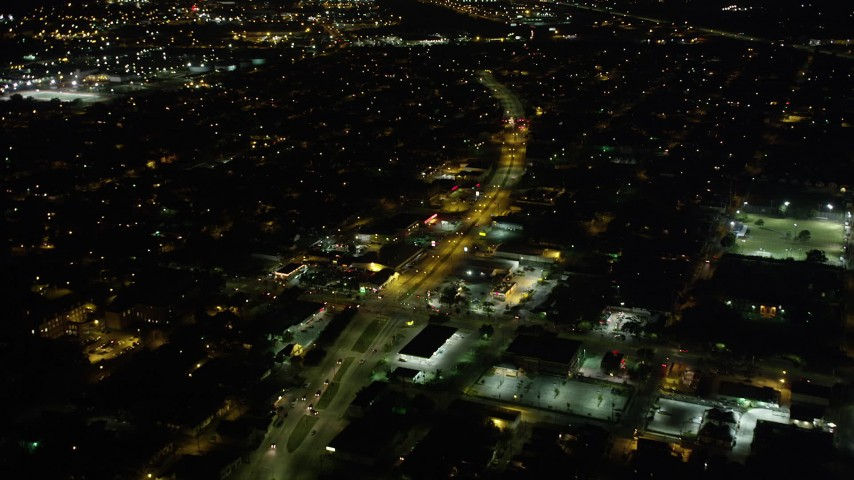 5K stock footage aerial video fly over shops and Earhart Boulevard at night, Carrollton, New Orleans, Louisiana Aerial Stock Footage | AX63_034