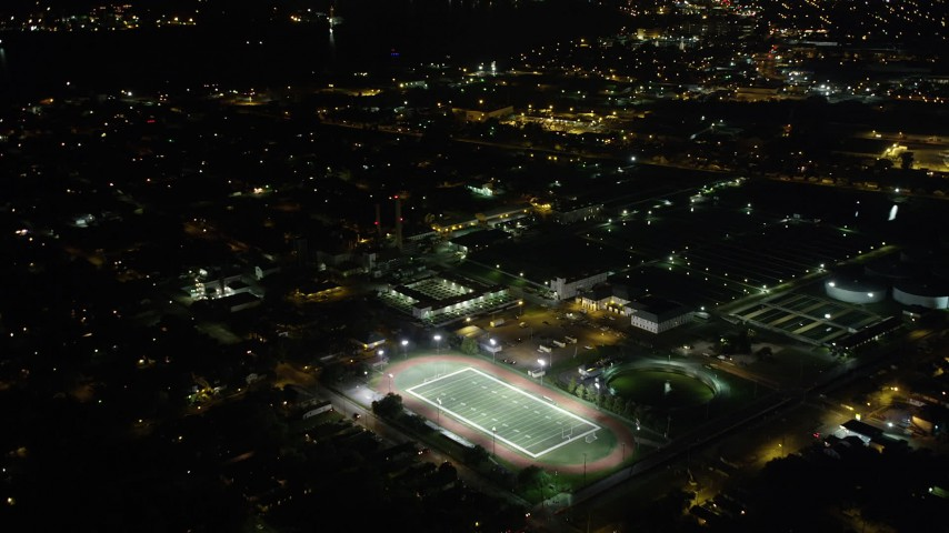 5K stock footage aerial video fly over homes to approach Harrell Stadium at night, Carrollton, New Orleans, Louisiana Aerial Stock Footage | AX63_035
