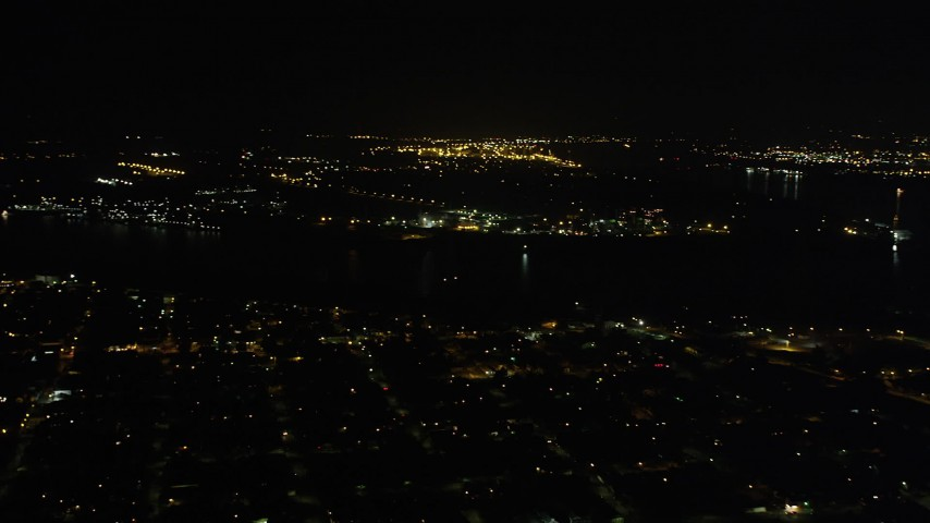 5K stock footage aerial video pan across Mississippi River and Carrollton neighborhoods at night, New Orleans, Louisiana Aerial Stock Footage | AX63_036