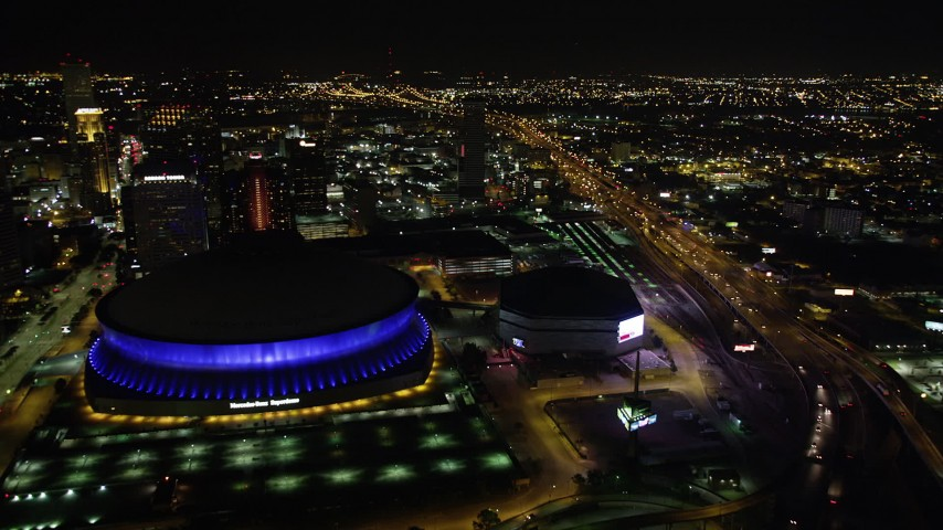 5K stock footage aerial video fly over the I-10 and Highway 90 interchange to approach Superdome in Downtown New Orleans, Louisiana at night Aerial Stock Footage | AX63_040