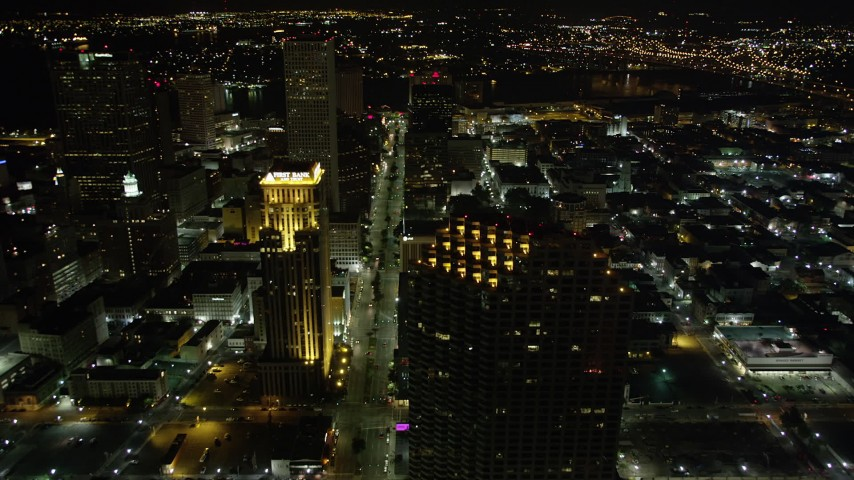 5K aerial video of following Poydras Street through Downtown New Orleans at night, Louisiana Aerial Stock Footage | AX63_041