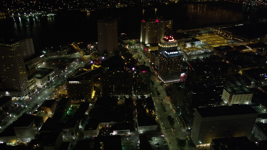5K aerial video fly over Poydras and Canal Streets in Downtown New Orleans at night, Louisiana Aerial Stock Footage | AX63_042