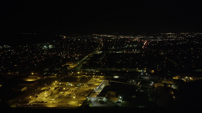 5K aerial video flyby warehouse buildings and neighborhoods in New Orleans East at night, Louisiana Aerial Stock Footage | AX63_048