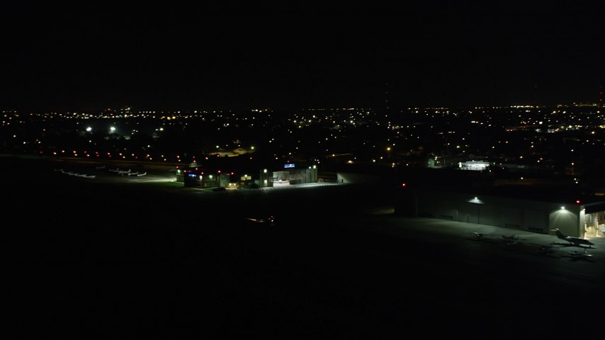 5K stock footage aerial video of civilian plane taxiing at New Orleans Lakefront Airport at night, Louisiana Aerial Stock Footage   AX63_050