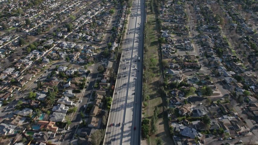 5K stock footage aerial video of Highway 170 freeway traffic through suburban neighborhoods in North Hollywood, California Aerial Stock Footage | AX64_0005