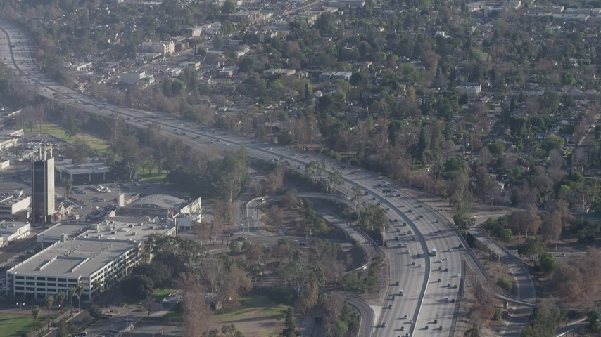 5K stock footage aerial video of Highway 170 with light traffic beside a shopping center in North Hollywood, California Aerial Stock Footage | AX64_0006