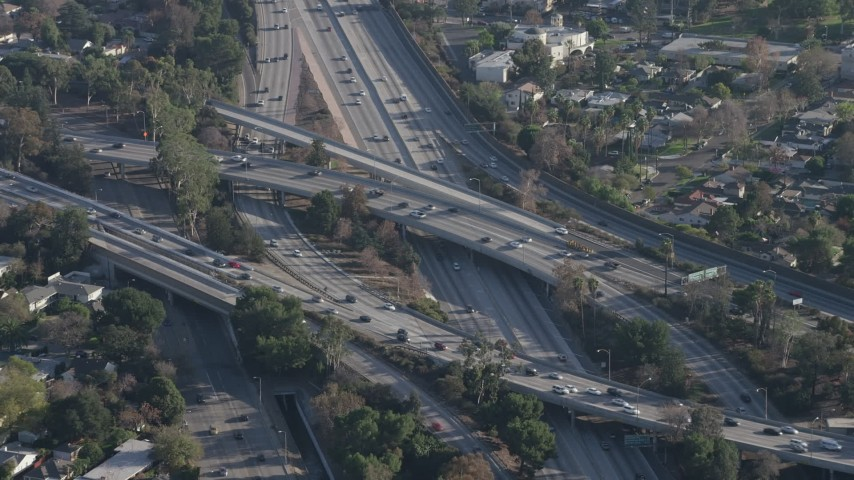 5K stock footage aerial video of traffic on Highway 170 and Highway 134 freeway Interchange in North Hollywood, California Aerial Stock Footage | AX64_0010