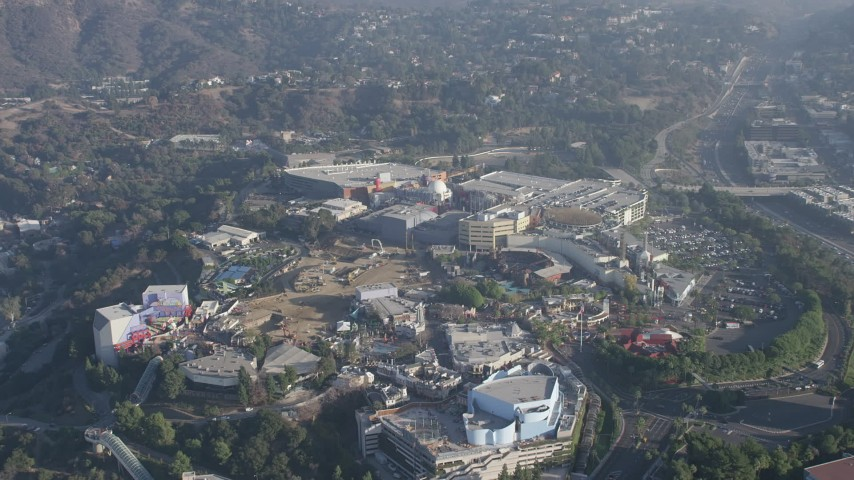 5K stock footage aerial video of approach and tilt to theme park in Universal City in California Aerial Stock Footage | AX64_0012