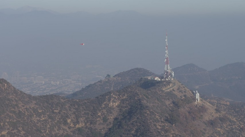 5K aerial video of emergency helicopter flying near Hollywood Sign, Los Angeles, California Aerial Stock Footage | AX64_0014