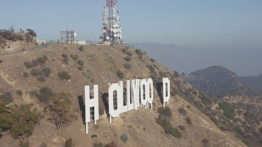 5K stock footage aerial video of flying by the iconic Hollywood Sign in Los Angeles, California Aerial Stock Footage | AX64_0018