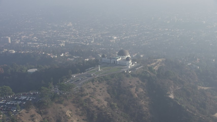 5K stock footage aerial video of Griffith Observatory in haze, Los Angeles, California Aerial Stock Footage | AX64_0019