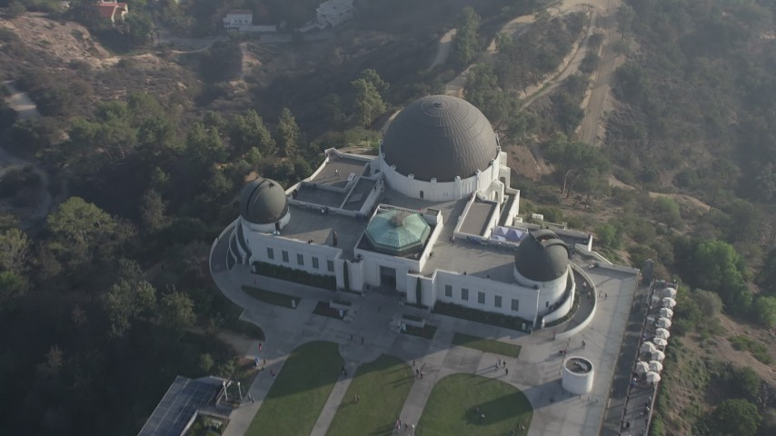 5K stock footage aerial video approach the Griffith Observatory in haze, Los Angeles, California Aerial Stock Footage | AX64_0020