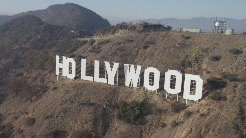 5K stock footage aerial video approach and fly over the Hollywood Sign, Los Angeles, California Aerial Stock Footage | AX64_0021