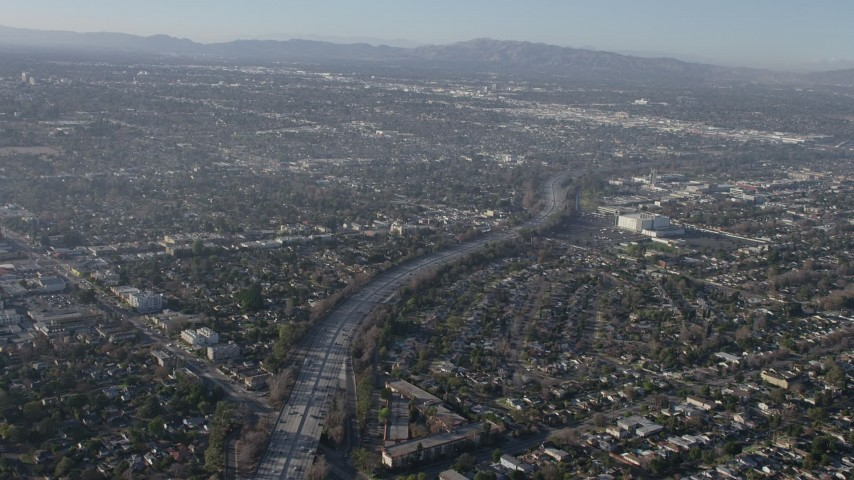 5K stock footage aerial video of the Highway 170 freeway between suburban neighborhoods in North Hollywood, California Aerial Stock Footage | AX64_0027