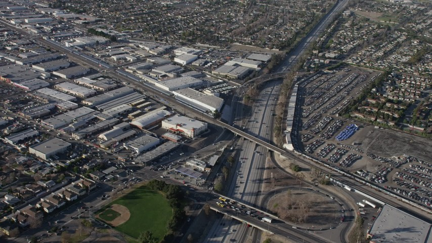5K stock footage aerial video of warehouse buildings beside Highway 170 freeway in North Hollywood, California Aerial Stock Footage | AX64_0030
