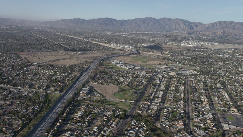 5K stock footage aerial video fly over suburban homes to approach Highway 170 / I-5 freeway split in Sun Valley, California Aerial Stock Footage | AX64_0032