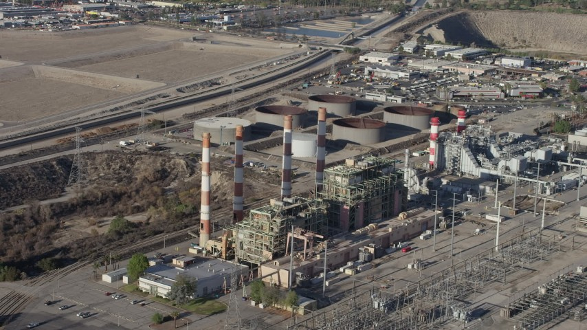 5K stock footage aerial video of LADWP Valley Generating Station smoke stacks, Sun Valley, California Aerial Stock Footage | AX64_0038