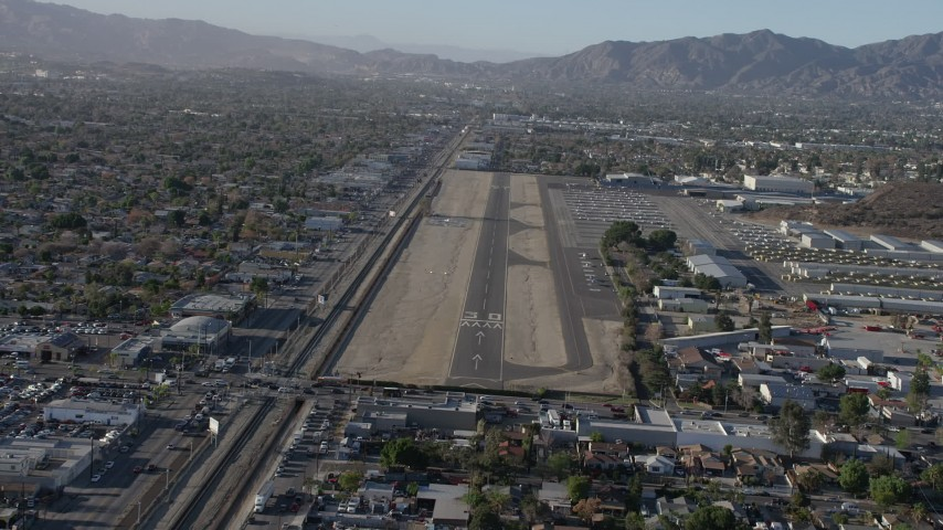 5K stock footage aerial video of approaching runway at Whiteman Airport, Pacoima, California Aerial Stock Footage | AX64_0041