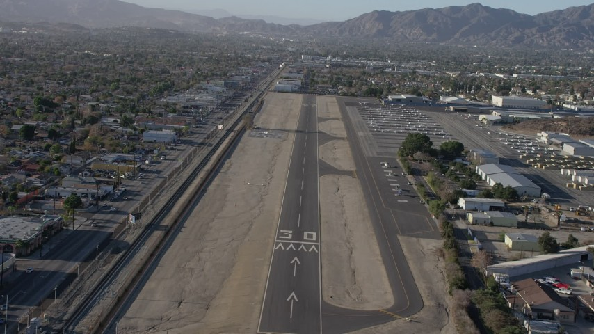 5K stock footage aerial video of descending toward the runway at Whiteman Airport, Pacoima California Aerial Stock Footage | AX64_0042