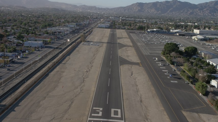 5K stock footage aerial video of descending toward an airport runway at Whiteman Airport, Pacoima California Aerial Stock Footage | AX64_0043