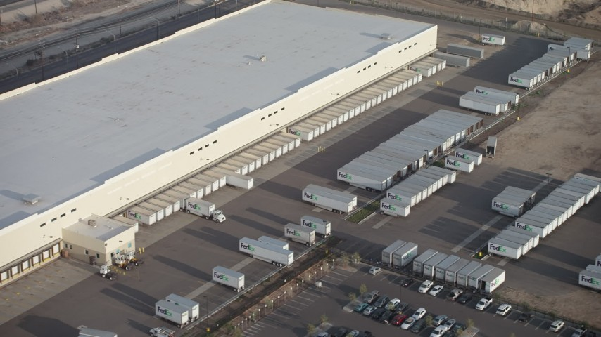 5K stock footage aerial video of trucks and trailers at a Fed-Ex warehouse in Pacoima, California Aerial Stock Footage | AX64_0046