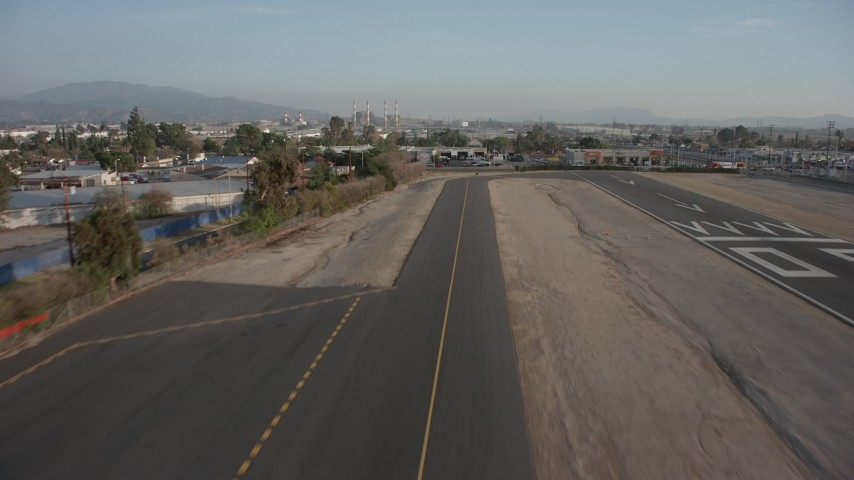 5K stock footage aerial video of lifting off from the runway at Whiteman Airport, Pacoima, California Aerial Stock Footage | AX64_0047