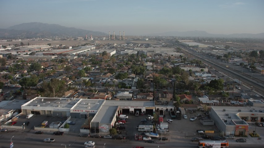 5K stock footage aerial video of fly over homes to approach warehouses and power plant in Pacoima and Sun Valley, California Aerial Stock Footage | AX64_0048