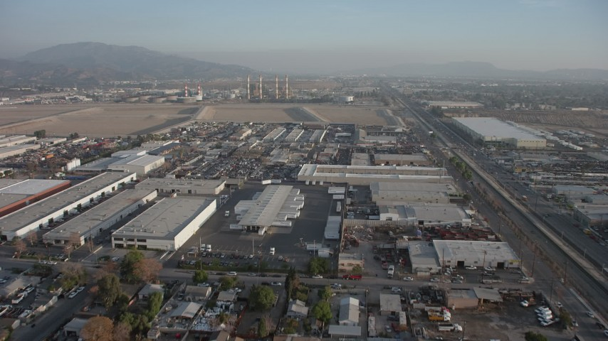 5K stock footage aerial video of warehouses near power plant with smoke stacks, Pacoima and Sun Valley, California Aerial Stock Footage | AX64_0049