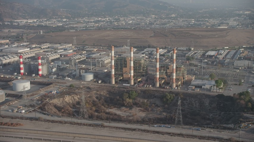 5K stock footage aerial video of LADWP Valley Generating Station and smoke stacks, Sun Valley, California Aerial Stock Footage | AX64_0050