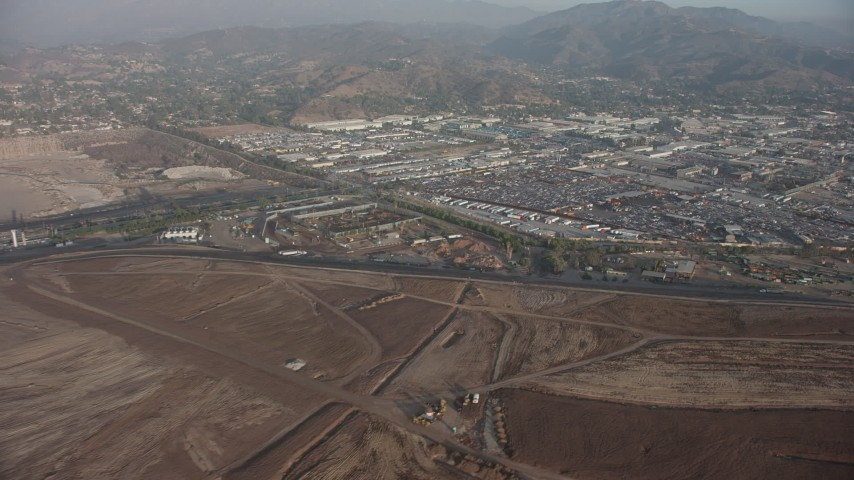 5K stock footage aerial video of car junkyard and warehouse buildings in Sun Valley, California Aerial Stock Footage | AX64_0052