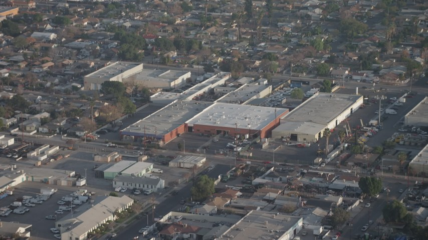 5K stock footage aerial video approach a group of warehouse buildings in Sun Valley, California Aerial Stock Footage | AX64_0053