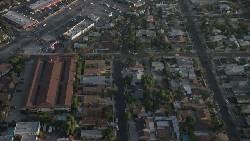5K stock footage aerial video fly over homes, apartment building, and reveal a strip mall in Sun Valley, California Aerial Stock Footage | AX64_0056