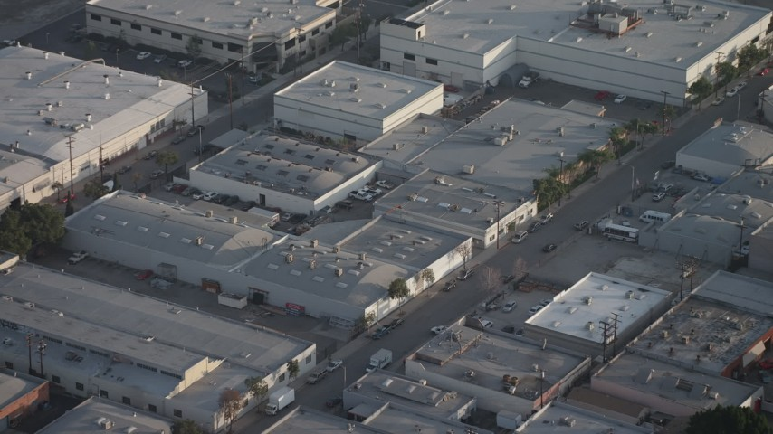 5K stock footage aerial video fly over office buildings and tilt to their rooftops in Burbank, California Aerial Stock Footage | AX64_0059