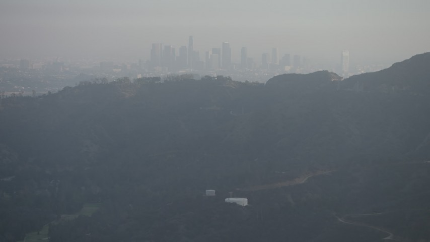 5K stock footage aerial video of Downtown Los Angeles skyline seen from the Hollywood Hills, California Aerial Stock Footage | AX64_0066