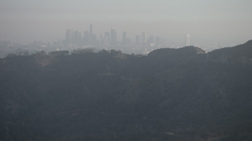 5K stock footage aerial video of Downtown Los Angeles skyline shrouded in haze, California Aerial Stock Footage | AX64_0067