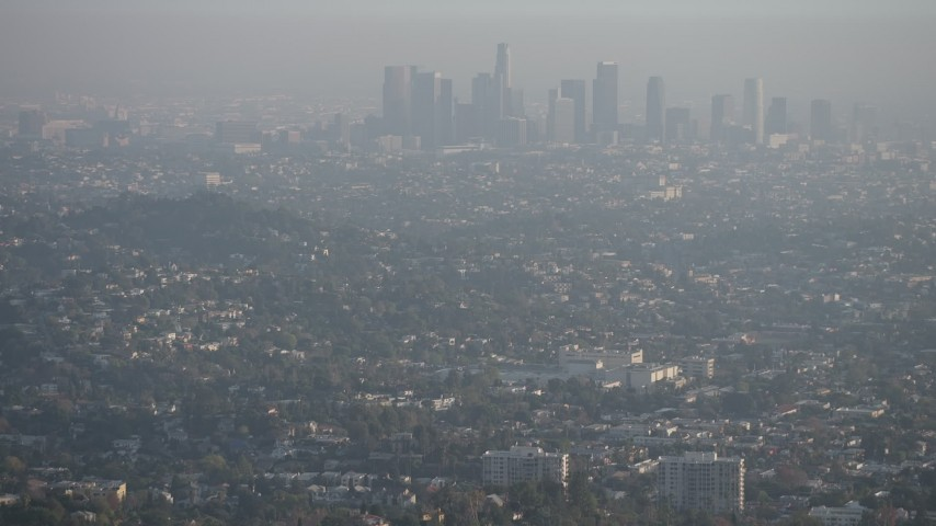 5K stock footage aerial video fly over the Hollywood Hills to reveal Downtown Los Angeles and city sprawl, California Aerial Stock Footage | AX64_0071