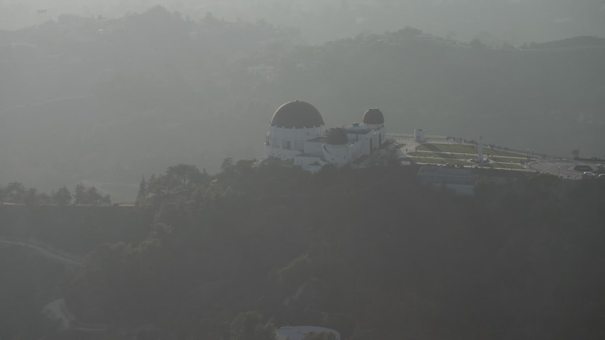 5K stock footage aerial video flyby the Griffith Observatory in haze, Los Angeles, California Aerial Stock Footage | AX64_0072