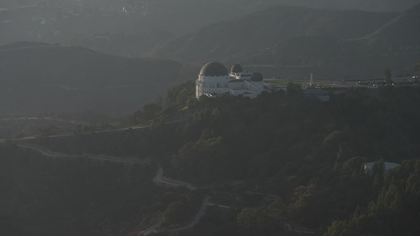 5K stock footage aerial video of a reverse view of the Griffith Observatory in haze, Los Angeles, California Aerial Stock Footage | AX64_0073