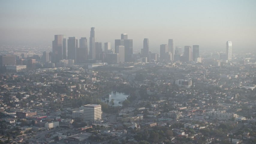 5K stock footage aerial video of Downtown Los Angeles and city sprawl in haze, California Aerial Stock Footage | AX64_0076
