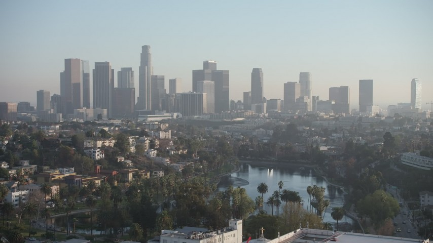 5K stock footage aerial video of Echo Lake and the Downtown Los Angeles skyline, California Aerial Stock Footage | AX64_0079